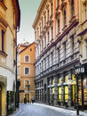 Narrow street shops prague street cobblestones january evening atmosphere Royalty Free Stock Photo