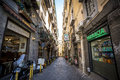 Narrow street with small businesses in Naples, Italy Royalty Free Stock Photo