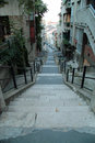 Narrow street with stairs in Budapest Royalty Free Stock Photo