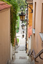 Narrow street with stairs and lamps in the old town of warsaw poland Royalty Free Stock Image