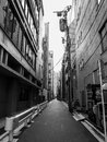 Narrow street in tokyo with tall buildings japan Royalty Free Stock Image