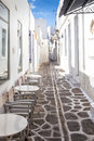 Narrow street with white houses on paros island greece traditional in parikia the capital of parikia harbour is a major hub for Royalty Free Stock Photos