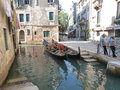 Narrow streets of venice looking for little romance on gondola is the best place to get the taste network blue lagoons and canals Stock Image