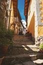 Narrow town street at daytime. Royalty Free Stock Photo