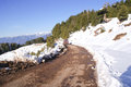 A narrow track through the snow covered mountains Royalty Free Stock Photo