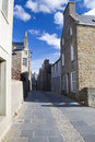 Narrow traditional street orkney stone built houses in stromness Stock Images