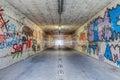 Narrow tunnel with graffiti Royalty Free Stock Photo