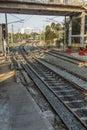 Narrow view of curve train tracks and foot over bridge,  Chennai, Tamil nadu, India, Mar 29 2017 Royalty Free Stock Photo