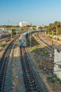 Narrow view of a running train on curve track from the foot over bridge,  Chennai, Tamil nadu, India, Mar 29 2017 Royalty Free Stock Photo