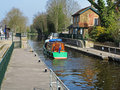 Narrowboat leaving a Lock on the River Thames Royalty Free Stock Photo