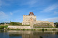 Narva castle on the river bank in summer day Royalty Free Stock Photos
