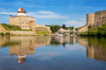 Narva river estonian russian border europe hermann fortress in estonia and ivangorod fortress in russia Stock Photos