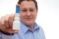 Nasal spray man Royalty Free Stock Photo