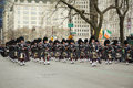 Nassau Police Pipes and Drums marching at the St. Patrick's Day Parade Royalty Free Stock Photo