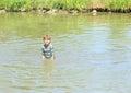 Nasty boy standing in water