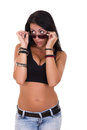 Nasty girl with sunglasses possing in jeans Royalty Free Stock Photos