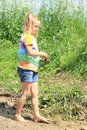 Nasty girl waling in mud happy little barefoot with ponytails walking Stock Photos