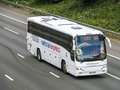 National express bus white on the motorway Royalty Free Stock Image