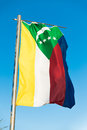 National flag of Comoros on flagpole Royalty Free Stock Photo