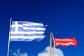 National flag of greece and no lifeguard flag with blue sky in background Royalty Free Stock Images