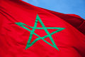 National flag of morocco above blue sky clear Stock Photos