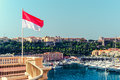 National flag of of the principality of monaco and view port Stock Images