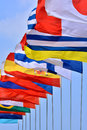 National flags from different countries getting together under blue sky shown as worldwide country and international communication Stock Image