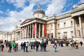 The national gallery london uk april tourists and street artists outside in trafalgar square on th april houses Stock Photography