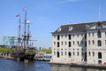 National maritime museum and dutch sailing cargo ship of cent amsterdam netherlands may century amsterdam netherlands Royalty Free Stock Image