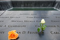National memorial at ground zero two roses are left beside the name of alan d feinberg a fire fighter of the new york fire Stock Photos