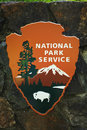 National park service logo sign this wooden is an example of the familiar united states Stock Photos