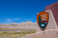 National park service sign hangs alongside road badlands national park Stock Photo