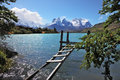 The national park torres del paine in chile boat dock on lake pehoe on opposite side of lake majestic snow capped cliffs of Royalty Free Stock Images