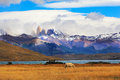 National park torres del paine chile lake laguna azul in the mountains on the shore of lake grazing horses impressive landscape in Stock Photography