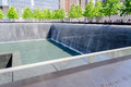 National september memorial new york may nyc s at world trade center ground zero seen on may the is located at the world trade Stock Photo