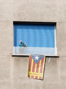 Nationalist flag of catalonia barcelona october window with blue shutters and retracted hanging in support the independence Stock Image