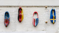 Nations wood clogs on a wall painted in the national flag colors of four countries Royalty Free Stock Photos