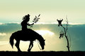 Native America Indian on horseback at sunset Royalty Free Stock Photo