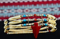 Native american artifacts traditional choker necklace of bone coral silver and turquoise in high contrast setting artifact of Stock Image