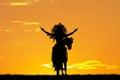 Native American Indian on horseback at sunset