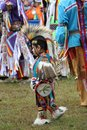 Native american youngster gathers with elders during pow wow in nashville tn Royalty Free Stock Images
