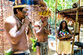 Native Brazilian group playing wooden flute at an indigenous tribe in the Amazon Royalty Free Stock Photo