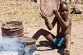 Native himba boy cooking lunch namibia Stock Photography