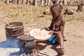 Native himba boy cooking lunch namibia Royalty Free Stock Image