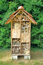 Native mason bee nesting box tree house complex pollination and housing made of wood as a for attracting pollinating bees Royalty Free Stock Photos