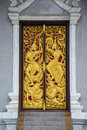 Native Thai style carving, painting on church door in Thai templ Royalty Free Stock Photo