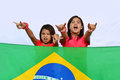 Native young brazilian supporters two girls supporting their country standing behind a national flag outdoor Royalty Free Stock Photography