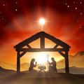Nativity christian christmas scene with baby jesus in the manger in silhouette and star of bethlehem Stock Photo