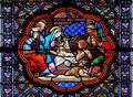 Nativity Scene, Adoration of the Shepherds, stained glass window in the Basilica of Saint Clotilde in Paris Royalty Free Stock Photo
