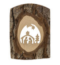 Nativity scene carved in a tree bark Royalty Free Stock Photo